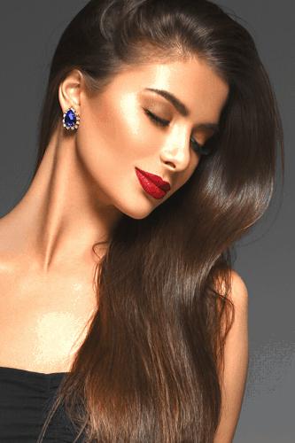 Beautiful brunette woman with sleek, shiny hair.