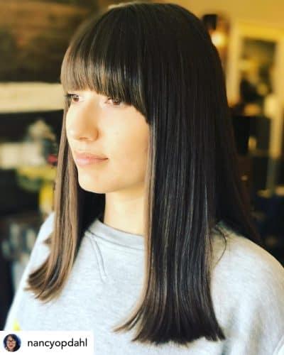 Mod bangs on beautiful brown hair.