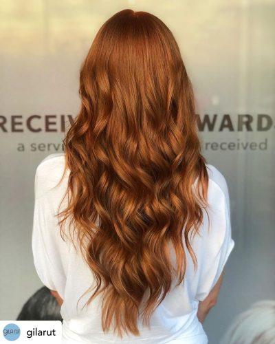 Beautiful auburn hair color.