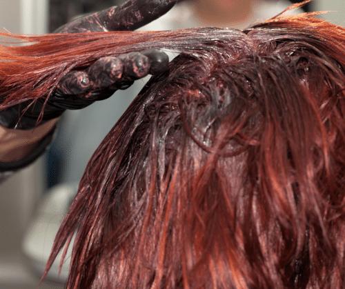 Woman having hair colored.