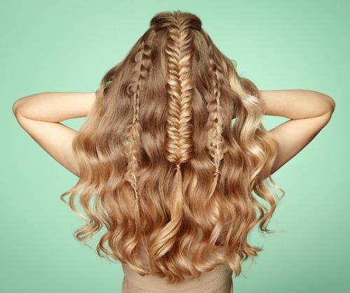 Beautiful fishtail braids on long, wavy blonde hair.