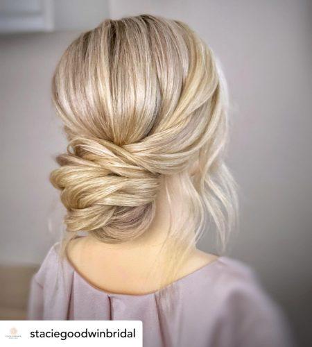 Beautiful low bun bridal hair/bridesmaid updo hairstyle.