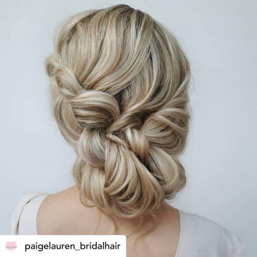 Beautiful braided low bun bridal hair/bridesmaid updo hairstyle.