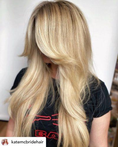 Beautiful curtain bangs on long layered haircut.